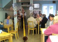 Party in celebration of five years of a Swiss cafe, Bexhill on Sea, East Sussex