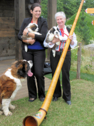 Alphorn with St. Bernard puppies at the Swiss Garden, RHS Hampton Court Flower Show