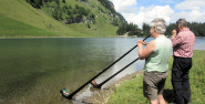 Wonderful echoes from two carbon alphorns as they float in the water, with Rolf, Seealpsee, Canton Appenzell, Switzerland